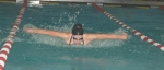 Sophomore Cassie Hacker attempts to take charge of the 200-yard individual medley during the butterfly leg at the Huntington North High School girls' swim meet with visiting Warsaw on Wednesday, Dec. 9. Hacker placed second in the event.