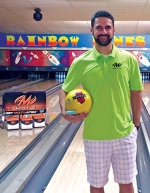 Eric Tackett, of Huntington, stands with gear from bowling goods manufacturer MOTIV at Rainbow Lanes, in Huntington. Tackett secured a contract with MOTIV earlier this summer at a tournament in Michigan.