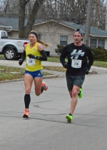 Lauren Johnson (left) and her husband, Nick, finish up the 5K portion of the 15th annual Kids Kampus Turkey Trot 5K Run/1 mile Walk on Thanksgiving morning, Nov. 28. Lauren Johnson was the top female finisher of the race, clocking in at 16:59.8, and her husband won men's 30 to 34 age group at 16:58.8. The Johnsons, of Huntington, are an assistant and head cross country coach, respectively, at Huntington University.