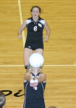 Huntington North High School volleyball player Este Stoffel (front) tries valiantly to keep the ball from landing out of bounds as teammate Allie Zahm comes over for back-up during the Lady Vikings' win over Kokomo on Thursday, Sept. 23.