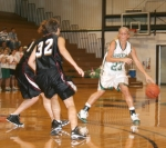 Freshman Lauren Meese doges two visiting Aquinas College defenders during the Huntington University women's basketball game on Tuesday, Nov. 10. The Foresters lost 71-68 in overtime.