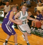 Huntington University senior Jenna Donaldson takes the ball down the court against tight defense by in the HU game against visiting Taylor Wednesday night, Dec. 3.