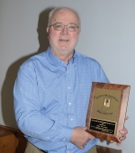 Bill Walker, of Huntington, displays the Indiana Basketball Hall of Fame President's Distinguished Service Award he was honored with on Wednesday, March 20, at the hall's annual banquet.