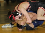 Huntington North High School senior Logan Randle dominates Cody Staggs of Oak Hill in th first round of the Peru Regional Wrestling Tournament on Saturday, Feb. 6. Randle went on to claim the 112 regional crown.