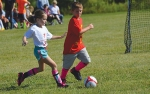 Harper Garrott (left) and Hugo Carlow each have their eyes on the ball during a 2019 fall soccer game. This year's Community Youth Fall Rec League practice sessions get underway the week of Sept. 7 for leagues 6U and older.