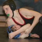 Freshman Ian Hiers (above) takes down Northfield's Thomas Rockenbaugh (below) at the Huntington North High School wrestling match on Wednesday, Jan. 13. The Vikings won with five pins on the day.