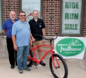Bicycle enthusiasts (from left) Huntington Mayor Brooks Fetters, Chris Bucher of Trailhouse Village Bicycles in Winona Lake and Jim Lewis of Huntington Area Recreational Trails Association display the bicycle that will be presented to the winner of the adult division of the HARTA Poker Ride on Sunday, June 19. Barry McManus (not pictured) of Trailhouse Village Bicycles donated the bike. In addition, Walmart will donate a $50 gift card to the winner of the children/youth division that can be used toward a bicycle purchase.