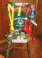 This chair decorated by Huntington County Special Olympics features the many sports included in its program. The chair is one of a dozen to be auctioned during the Chair-ity Affair on Aug. 10.