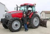 John Easterday, of Huntington, stands with a tractor on his property.