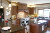The large kitchen in the Patmore residence features a commercial range with a handcrafted hood and an island that houses a refrigerator, freezer and microwave. The home will be featured in Tri Kappa's Housewalk on Oct. 4.
