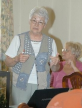 Linda Bordeaux, director of the Neighborhood Naturally Occurring Retirement Communities (NNORC) program, explains the group's accomplishments over the past 14 years during a wrap-up luncheon Thursday, June 18, at the LaFontaine Center.