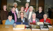 The Samuel Huntington Chapter of the Daughters of the American Revolution presented scrapbooks of the chapter's history to Joan Keefer of the Indiana Room in the Huntington City-Township Public Library. Pictured are (front row from left) Judy Kaltenmark,