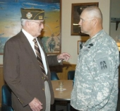 Ted Rogers (left), who organized the Huntington-based unit of the Army National Guard, talks with the company's most recent commander, Command Sgt. Maj. Jeffrey Duncan, during a welcome home party Saturday, April 25, for Delta Company.