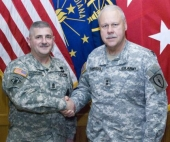 Command Sgt. Maj. Curt Juergens, of Huntington, is congratulated by Indiana's adjutant general, Maj. Gen. R. Martin Umbarger, after Juergens received his most recent appointment.