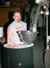 Jerry Meehan, an employee of Metalloid Corp., Huntington, IN, transfers chemicals into a drum. The company ships drums across North America to customers that use the chemicals in a variety of production applications.