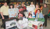 Huntington North High School Post Prom Prize Committee members pose with some of the items already donated for the May 17 event.