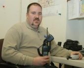 Brandon Taylor, director of the Huntington County Emergency Management Agency, holds of the new 800 megahertz radios now being used by emergency responders throughout Huntington County.