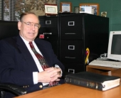 Rev. James Bachman at his desk.
