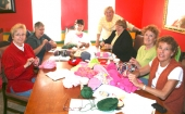 Linda Lakes, Cindy Shideler, Kathy Harrell, Beth Fulton, Sandy Diffenbaugh, Dortha Beachy and Sally Schenkel (from left) are members of The Loose Ends, a knitting and crocheting group.