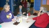 Getting ready for a game of cards while passing the time Friday, Jan. 16, at a warming shelter set up at the Salvation Army, in Huntington, are (from left) Berniece Moore, Nancy Moore and Ellen Fisher.