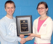 Josh Miller, program director of the Huntington County Boys and Girls Club, presents Huntington North High School senior Tiffany Smith with he chapter's youth of the year award on Wednesday, March 25.