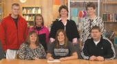 North Miami basketball standouot Alicia Burrus (front, center) signs a letter of intent to play for Huntington University recently.