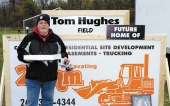 Tom Hughes, a longtime Huntington Police Athletic League board member and recently retired Huntington police officer, stands by a field at the PAL grounds on Saturday, Oct. 26, that is currently under construction and will be named in his honor.