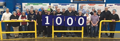 Employees of the Huntington Ecolab plant celebrate 1,000 safe days by posing for a group photo. They were treated to a barbecue meal, served by the facility's plant leadership and senior leaders.