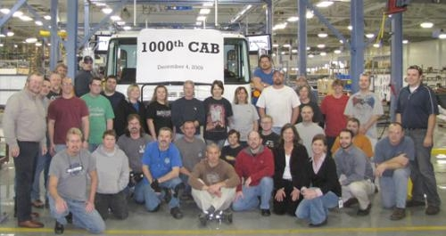 Workers at the Huntington Bendix Commercial Vehicle Systems LLC plant recently celebrated the rollout of the 1,000th Autocar cab off the assembly line.