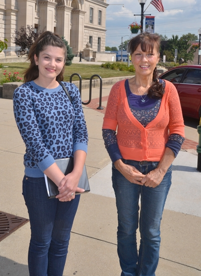 Katy Strass (left) and Pam Burris are putting together Huntington's first Chalk Walk, which will see the sidewalks around the Huntington County Courthouse filled with chalk drawings on Saturday, Sept. 30.