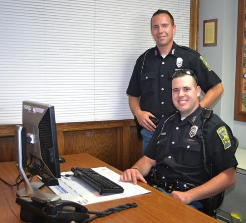 Shane Blair (standing) and Benjamin Spurgeon are the newest officers with the Huntington Police Department.