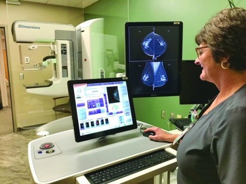 Kelli Lesh, mammography technologist at Parkview Huntington Hospital, navigates some of the features of the hospital's new 3D mammography system. The new technology – which produces clearer, more detailed images than the previous 2D mammography – can lead to earlier diagnosis of breast cancer.
