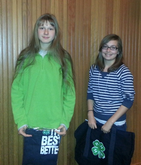 Emma Melcher (right) submitted the winning entry in a contest to design a logo and theme for the 2013 Huntington County 4-H Fair. Amanda Pugh (left) placed third in the contest.