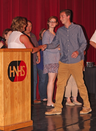 Jared Smith (right) shakes Michele Santa's hand upon being named one of two Students of the Year for Huntington North High School's ICE program during the Huntington North Achievement Night, held in the school's auditorium on Friday, May 12. Tabitha Jaggers was named the program's other outstanding student.