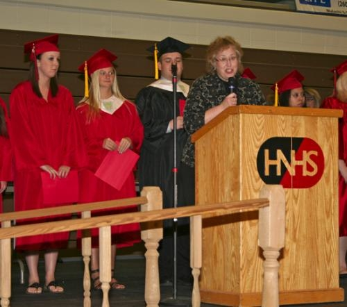 Ruth Reed, director of the Masque & Gavel Club at Huntington North High School, invites all students who participated in the program to the stage during the school's Achievement Night on Monday, May 13.