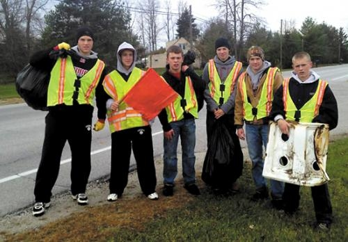 "Huntington North High School students pose with some of the trash they picked up along two highways near Huntington as part of the HNHS baseball program's participation in the state ""Adopt-A-Highway"" project."