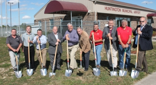 Helping to break ground on Friday, Sept. 29, for Phase II of an apron expansion project at Huntington Municipal Airport are (from left) Tony Korba, E&B Paving; Tom Mettler, Mettler Agency Inc.; Mark Wickersham, Huntington County Economic Development; Chris Crabtree, representing Congressman Jim Banks; Ind. Sen. Andy Zay; Ind. Rep. Dan Leonard; Gregg Koppelmann, E&B Paving; Ken Ross, vice president, NGC Corp. Aviation Consulting; Junior Geiger, president, Huntington Municipal Airport Board of Aviation Commissioners; and Huntington Mayor Brooks Fetters.