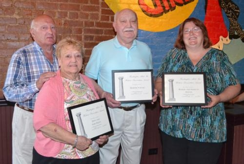 Huntington Alert recognized (from left) Dave Hasty, Mary Hasty, Martin Young and Marilyn Stefan for rehabilitation work on a barn, garage and home that preserved the historical integrity of the structures.