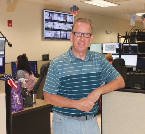 Tim Allen stands inside the Huntington County dispatch center on Wednesday, July 3. Allen, himself a former dispatcher, became the new combined dispatch director on June 24, after working 15 years at the Parkview Huntington Family YMCA.
