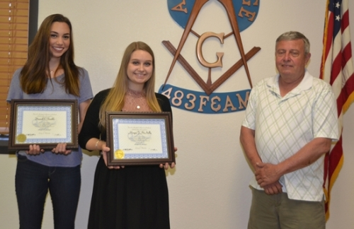 Hannah Frankle (left) and Morgan McNally (center) accept college scholarship awards from Les Howe, master of Amity Lodge 483 F&AM.