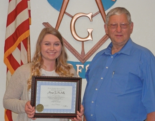 Morgan McNally (left), of Huntington, was recently awarded a $1,300 Masonic Scholarship by the scholarship board of the Grand Lodge of Indiana Free and Accepted Masons.  Ed Herschberger, worshipful master of the local Amity Lodge 483 F&AM, made the presentation to her.