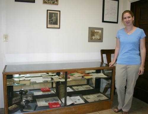 Nancy Disbro, librarian for the Andrews-Dallas Township Public Library, stands beside a display case of Andrews memorabilia at the library on Wednesday, Sept. 15. The library is seeking historic photographs of the town for a scrapbook.