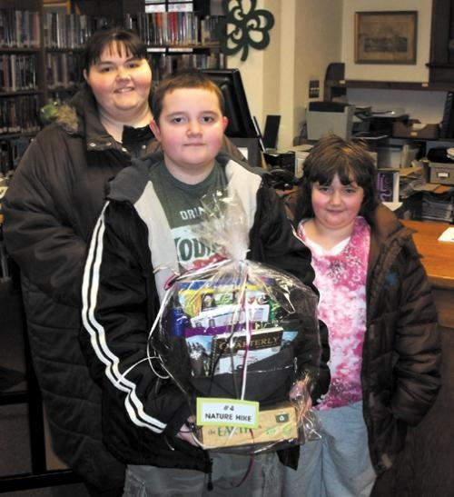 Sandra, Peyton and Riley Denney (from left) were among the winners in the Andrews-Dallas Township Public Library's family reading club held over the winter. They won the Nature Hike basket.