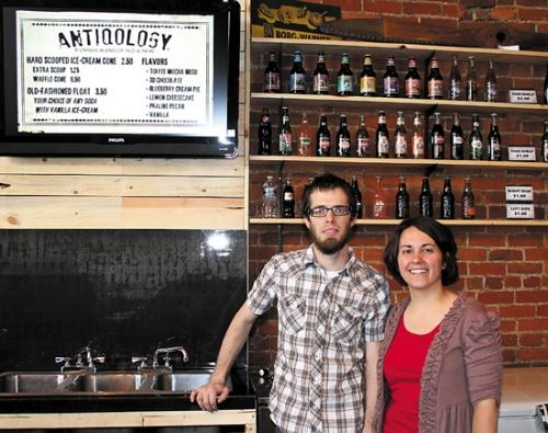 Antiqology owners Rebecca (right) and Adam Hanson stand behind the serving counter in their store's new location, 401 N. Jefferson St. The store moved down the street after winning the Huntington County Visitor Bureau's business plan contest this spring.
