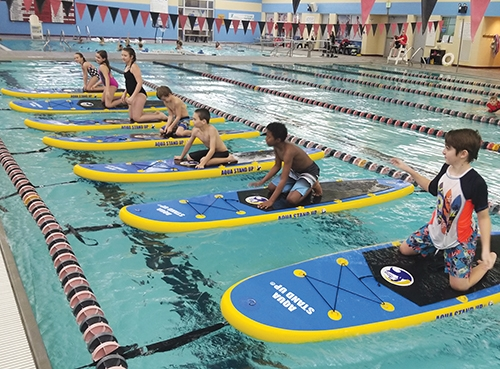 Homeschool PE students have fun with Kid's Aqua Stand Up during a recent PE session at the Parkview Huntington Family YMCA.Community kids are invited to give Aqua Stand Up a try at the upcoming launch party on Saturday, March 16.