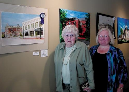 Ellen Harmsen (left), of Wabash, and Huntington artist Connie Teusch are shown with Harmsen's best of show entry in the Historical and Architectural Art Show at the Artistica Gallery, in Wabash. Teusch won an honor award for her entry.