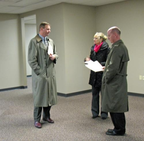 First Federal Savings Bank President and CEO Michael Zahn (left) and Chief Financial Officer Randy Sizemore discuss plans for the Parkview Huntington Hospital Autism Center with Kay Schwob in the space at 2806 Theater Ave., where the center will open.