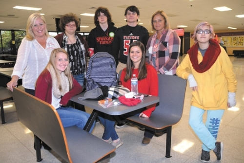 Huntington North High School students will collect donations to fill backpacks for the homeless Saturday morning, Nov. 4, at the school. Displaying some of the donations that are needed are (seated, from left) students Emma Bickel and Sara Kauffman; and (standing, from left) Shelley Septer, who founded Backpacks of Hope in honor of her late son; students Andrea Sands, Noah Proffitt and Cade MacAleese; HNHS teacher Michelle Santa; and student Merrill Ballinger.