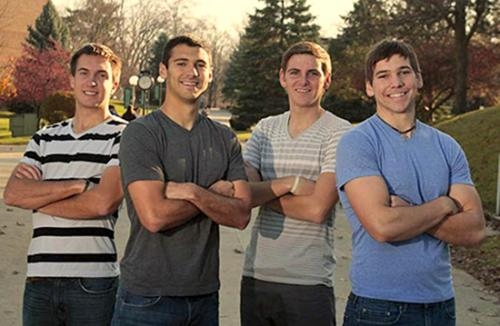 Huntington University students, Isaac Beal (second from left) and Jake Essig (third from left), along with their friends, Nick Streibick (left) and Derek Garde, plan to dribble soccer balls from Monroe, OH, to Toledo  to raise money for the homeless.
