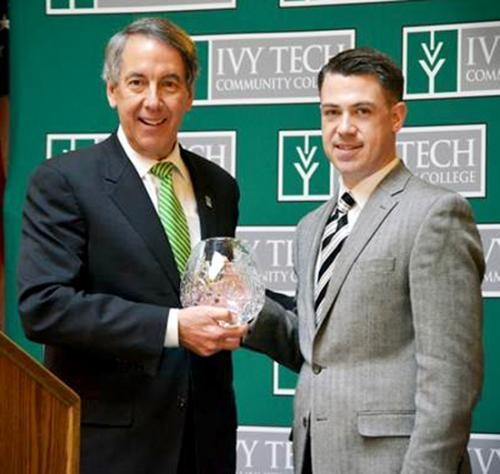 Ivy Tech Community College President Thomas J. Snyder (left) presents State Sen. Jim Banks, R-Columbia City, the Distinguished Public Official Award at the institution's 50th anniversary celebration at the Indiana Statehouse on Feb. 26.